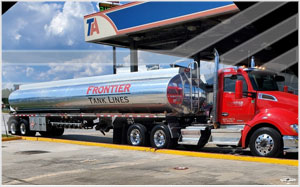 frontier tank lines truck at gas station